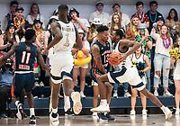 WASHINGTON, DC - NOVEMBER 16: Troy Baxter of Morgan State blacks Maceo Jack #14 of George Washington during a game between Morgan State University and George Washington University at The Smith Center on November 16, 2019 in Washington, DC.