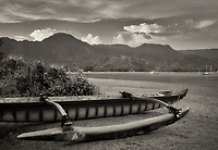 Outrigger canoe on Hanalei Beach, with sunrise. Kauai, Hawaii