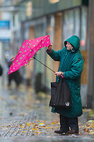 "Monday  21 November 2014<br /> Pictured: A woman struggles with an umbrella<br /> Re: A yellow ""be aware"" weather warning has been issued as widespread heavy rain hits the country. The Met Office said gusts of winds could hit 50mph (80km/h) with localised flooding and disruption to travel."