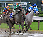 29 August 2009: Vineyard Haven (blue cap) and Capt. Candyman Can battle to the wire in the King's Bishop Stakes at Saratoga Race Track in Saratoga Springs, New York. Vineyard Haven was disqualified for interference in the stretch making Capt. Candyman Can the winner.
