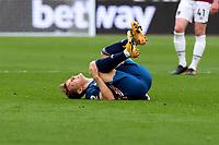 21st March 2021; London Stadium, London, England; English Premier League Football, West Ham United versus Arsenal; Martin Odegaard of Arsenal goes down injured