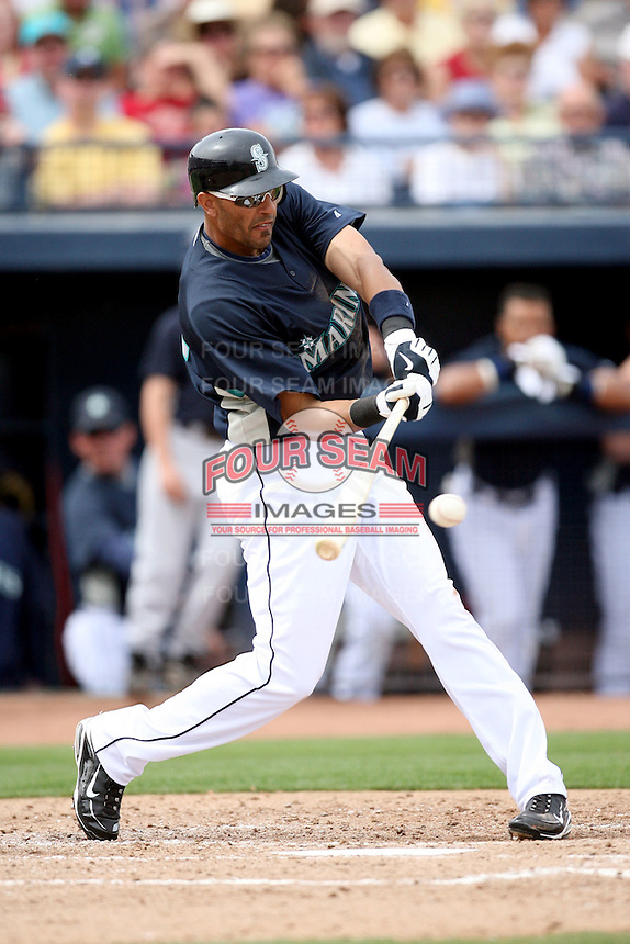 March 8, 2009: Mike Morse (12) of the Seattle Mariners at Peoria Sports Complex in Peoria, AZ.  Photo by: Chris Proctor/Four Seam Images