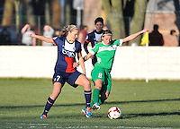 20131211 - HENIN-BEAUMONT , France :  PSG 's Lindsey Horan (left)  pictured in a duel with Henin's Marie Schepers (right) during the female soccer match between FC Henin Beaumont and Paris Saint-Germain Feminin , of the Ninth matchday in the French First Female Division . Wednesday 11 December 2013. PHOTO DAVID CATRY