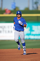 Dunedin Blue Jays second baseman Christian Lopes (11) runs the bases after hitting a home run during a game against the Clearwater Threshers on April 8, 2016 at Bright House Field in Clearwater, Florida.  Dunedin defeated Clearwater 8-3.  (Mike Janes/Four Seam Images)