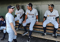 Manager Carlos Mendoza (8) of the Charleston RiverDogs, far left, talks with Kelvin De Leon, left, Gary Sanchez, center, and Ali Castillo before a game against the Greenville Drive on June 3, 2012, at Fluor Field at the West End in Greenville, South Carolina. Charleston won, 5-3. (Tom Priddy/Four Seam Images)