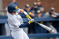 Michigan Wolverines catcher Joe Donovan (0) swings the bat against the Rutgers Scarlet Knights on April 27, 2019 in the NCAA baseball game at Ray Fisher Stadium in Ann Arbor, Michigan. Michigan defeated Rutgers 10-1. (Andrew Woolley/Four Seam Images)
