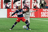 FOXBOROUGH, MA - NOVEMBER 20: Teal Bunbury #10 of New England Revolution and Zachary Brault-Guillard #15 of Montreal Impact battle for the ball during the Audi 2020 MLS Cup Playoffs, Eastern Conference Play-In Round game between Montreal Impact and New England Revolution at Gillette Stadium on November 20, 2020 in Foxborough, Massachusetts.(Photo by Andrew Katsampes/ISI Photos/Getty Images).