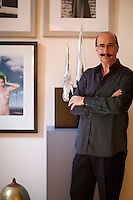 portrait of Yeros Dimitris..Dimitris Yeros lives in downtown Athens, Greece. His house style keeps pace with his personal taste of classical and minimal, and it is decorated with many of his artworks.