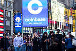 An electronic billboard displays Coinbase Global Inc. signage during the company's initial public offering (IPO) outside of the Nasdaq MarketSite in New York, U.S., on Wednesday, April 14, 2021. Photograph by Michael Nagle
