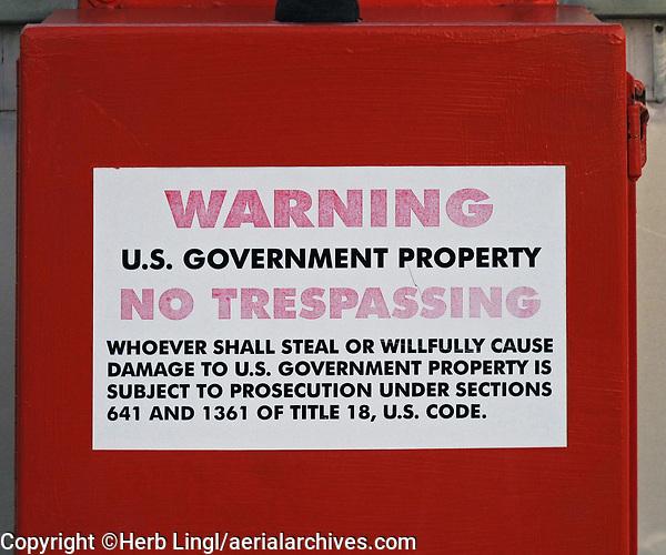 US Government Property warning on the visual approach slope indicator (VASI) light cover box at the Petaluma Municipal Airport, Petaluma, Sonoma County, California