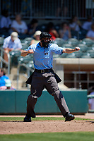 Umpire Nolan Earley strike three call during a South Atlantic League game between the Lexington Legends and Augusta GreenJackets on April 30, 2019 at SRP Park in Augusta, Georgia.  Augusta defeated Lexington 5-1.  (Mike Janes/Four Seam Images)