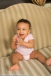 Infant development 9 month old baby girl clapping hands