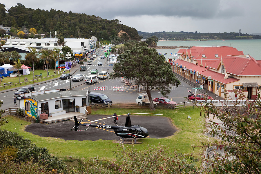 Marsden Road, Paihia, north island, New Zealand.  Sightseeing Helicopter in foreground, Ferry Terminal on right.  Waitangi Treaty Grounds on right in far background.