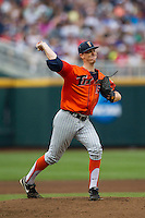 Cal State Fullerton Titans pitcher Thomas Eshelman (15) makes a pickoff throw to first base during the NCAA College baseball World Series against the Vanderbilt Commodores on June 14, 2015 at TD Ameritrade Park in Omaha, Nebraska. The Titans were leading 3-0 in the bottom of the sixth inning when the game was suspended by rain. (Andrew Woolley/Four Seam Images)