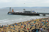 BNPS.co.uk (01202 558833)<br /> Pic: Graham Hunt/BNPS<br /> Date: 2nd September 2021.<br /> <br /> The Dakota of the Battle of Britain memorial flight passes by the pier and busy beach on day 1 of Bournemouth Air Festival in Dorset on a warm overcast day.