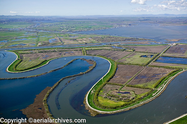 aerial photograph of levees in the Sacramento San Joaquin river delta, northern California; Quimby Island and Franks Tract in background