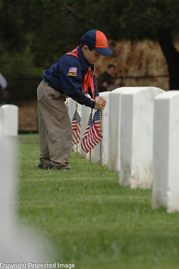 Saturday, May 22, 2009.  Fort Rosecrans National Cemetery, San Diego California, USA:  David Foust (7) of Troop 336 in Santee places a flag at a grave marker in Fort Rosecrans National Cemetary.  Hundreds of boy scouts, girl scouts and their parents fanned out across the cemetery to plant flags at each grave site to mark Memorial Day..
