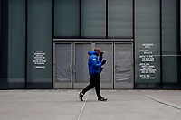 NEW YORK - NEW YORK - APRIL 02: A man walks in front of The Shed at Hudson Yards on April 02, 2021 in New York. New York takes another step forward to reopening arts and entertainment, venues are allowed to welcome back people with the guidelines say indoor spaces can have up to 100 audience members and outdoor venues can have 200. (Photo by John Smith/VIEWpress)
