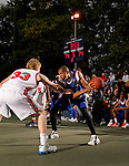 Gary Johnson (23) is defended by Kyle Singler (33) during the Elite 24 Hoops Classic game on September 1, 2006 held at Rucker Park in New York, New York.  The game brought together the top 24 high school basketball players in the country regardless of class or sneaker affiliation.