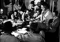 Chart room on board USS LEXINGTON as ship maneuvers into enemy waters during strike in the Gilbert and Marshall Islands.  December 1943.  Comdr. Edward J. Steichen.  (Navy)<br /> Exact Date Shot Unknown<br /> NARA FILE #:  080-G-431073<br /> WAR & CONFLICT BOOK #:  969