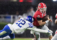 ATHENS, GA - OCTOBER 19: Jake Fromm #11 of the Georgia Bulldogs runs and is tackled by Chris Oats #22 of the Kentucky Wildcats during a game between University of Kentucky Wildcats and University of Georgia Bulldogs at Sanford Stadium on October 19, 2019 in Athens, Georgia.
