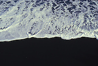 wave breaking on a black sand beach, Big Island of Hawaii