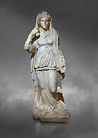 Roman statue of Selene. Marble. Perge. 2nd century AD. Inv no 2014/201. Antalya Archaeology Museum; Turkey.  Against a grey background<br /> <br /> Selene is the goddess of the moon. She is the daughter of the Titans Hyperion and Theia; and sister of the sun-god Helios; and Eos; goddess of the dawn. She drives her moon chariot across the heavens.