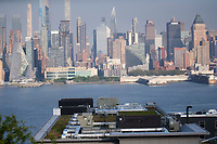 WEST New York , NJ - MAY 04: Air conditioning systems placed on buildings are seen as the New York skyline is on the background from West New York , New Jersey on May 04 2021. The Environmental Protection Agency moved on Monday to regulate hydrofluorocarbons, or HFCs, a class of man-made chemicals the use and production of powerful greenhouse gases central to refrigeration and air-conditioning and is thousands of times more potent than carbon dioxide at warming the planet. The proposal is the first significant step the E.P.A. has taken under President Biden to curb climate change.<br /> (Photo by Kena Betancur/VIEWpress/Corbis via Getty Images)