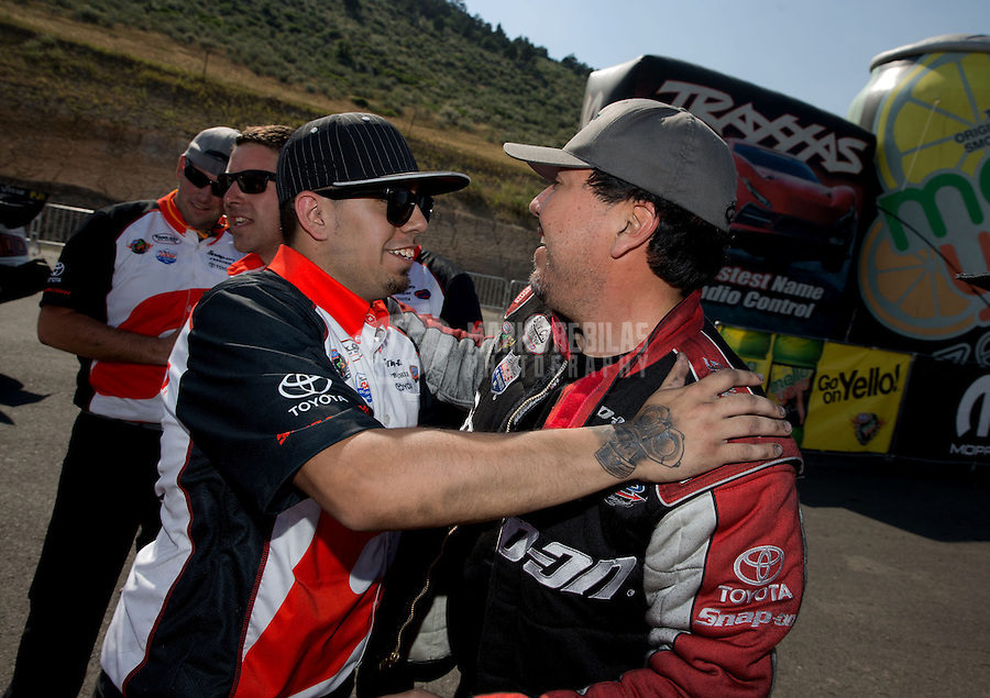 Jul. 21, 2013; Morrison, CO, USA: NHRA funny car driver Cruz Pedregon celebrates with his crew after winning the Mile High Nationals at Bandimere Speedway. Mandatory Credit: Mark J. Rebilas-