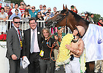 I'M A DREAMER, jockey Hayley Turner, owner Andrew Stone & Trainer David Simcock in the winner's circle after winning the Beverly D. at Arlington Park 8-18-12