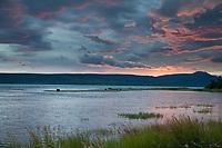 Colorful morning sunrise over the Brooks River and Naknek lake, Katmai National Park, Alaska.