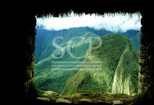 Machu Picchu, Peru. Window of an Inca building with view of the mountains.