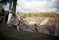"Kevin Pauwels (BEL/Sunweb-Napoleon Games) climbing out of ""The Pit""<br /> <br /> GP Zonhoven 2014"