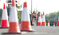 28 JUL 2013 - LONDON, GBR - Matthew Shutler negotiates the traffic cones marking the bike route during the 2013 Virgin Active London Triathlon at Royal Victoria Dock in London, Great Britain  (PHOTO COPYRIGHT © 2013 NIGEL FARROW, ALL RIGHTS RESERVED)