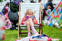 Hay on Wye, Wales, UK Saturday 28 May 2016<br /> Pictured: A young girl enjoys the sunshine at Hay <br /> Re: The 2016 Hay festival take place at Hay on Wye, Powys, Wales