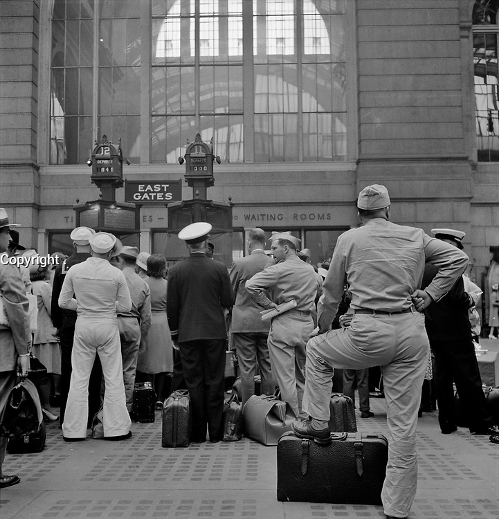 Servicemen waiting for trains at Pennsylvania railroad station, New York, New York. August 1942.<br /> <br /> Photo by Marjory Collins.