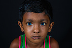 Pictured: Mehedi<br /> <br /> Family members with an unusual pigmentation show off their shockingly bright, blue eyes.  Eyes of this colour are rare for people of a darker skin tone, and the cause is a lack of melanin pigment in the iris of the eye.<br /> <br /> Lower levels of melanin are more commonly found in people with lighter skin tones, meaning they are more likely to have lighter coloured eyes.  The grandfather's name is Shukur Mia, who is photographed with his granddaughter Tasnim, 11, and grandson Mehedi, 6.  SEE OUR COPY FOR DETAILS.<br /> <br /> Please byline: Sultan Ahmed Niloy/Solent News<br /> <br /> © Sultan Ahmed Niloy/Solent News & Photo Agency<br /> UK +44 (0) 2380 458800