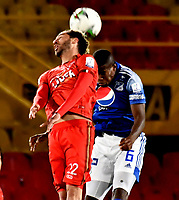 BOGOTA-COLOMBIA, 17-10-2020: Andres Roman de Millonarios y Carlos Ramirez de Patriotas Boyaca F. C. disputan el balon, durante partido entre Millonarios y Patriotas Boyaca F. C. de la fecha 15 por la Liga BetPlay DIMAYOR 2020 jugado en el estadio Nemesio Camacho El Campin de la ciudad de Bogota. / Andres Roman of Millonarios and Carlos Ramirez of Patriotas Boyaca F. C. figth for the ball, during a match between Millonarios and Patriotas Boyaca F. C. of the 15th date for the BetPlay DIMAYOR League 2020 played at the Nemesio Camacho El Campin Stadium in Bogota city. / Photo: VizzorImage / Luis Ramirez / Staff.