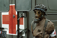 - French ambulance and medic in NBC uniform during NATO military exercises in Germany....- esercitazioni militari NATO in Germania, ambulanza francese e infermiere in tenuta NBC