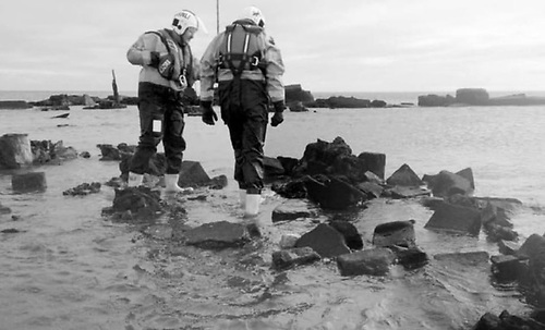 Lifeboat crew examine the remains of the sandpit village exposed in 2015 at Rosslare. Photo: Rosslare Maritime Heritage Centre Facebook