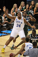 UCLA Bruins Joshua Smith #34 fights for position in front of Michigan State Spartans Derrick Nix #25 during the second round game of the NCAA Basketball Tournament at St. Pete Times Forum on March 17, 2011 in Tampa, Florida.  UCLA defeated Michigan State 78-76.  (Mike Janes/Four Seam Images)
