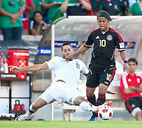PASADENA, CA – June 25, 2011: USA player Clint Dempsey (8) and Mexican player Giovani Dos Santos (10) during the Gold Cup Final match between USA and Mexico at the Rose Bowl in Pasadena, California. Final score USA 2 and Mexico 4.