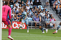 ST. PAUL, MN - AUGUST 21: Johnny Russell #7 of Sporting Kansas City crosses the ball in front of  Chase Gasper #77 of Minnesota United FC during a game between Sporting Kansas City and Minnesota United FC at Allianz Field on August 21, 2021 in St. Paul, Minnesota.