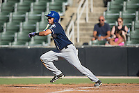 Omar Carrizales (19) of the Asheville Tourists follows through on his swing against the Kannapolis Intimidators at Intimidators Stadium on June 28, 2015 in Kannapolis, North Carolina.  The Tourists defeated the Intimidators 6-4.  (Brian Westerholt/Four Seam Images)