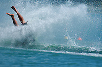 A Barefoot waterskier crashes hard during competition.