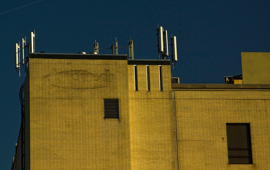 A tall building with a lot of mysterious devices on top of it. Could it be?