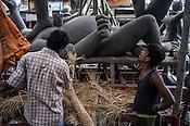 Sculptors work together to make Hindu Goddess (Kali) idols in Kumhartuli in Kolkata, West Bengal, India.