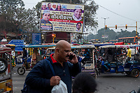 A political ad for the Aam Aadmi Party (AAP)  (the Common Man's Party) stands above the intersection of Chadni Chowk Road and Netaji Subhash Marg outside the Red Fort in Delhi, India, on Tue., Dec. 11, 2018.
