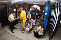Fans have their tickets scanned as they enter David F. Couch Ballpark for Game Four of the Winston-Salem Regional in the 2017 College World Series between the West Virginia Mountaineers and the Wake Forest Demon Deacons on June 3, 2017 in Winston-Salem, North Carolina.  The Demon Deacons walked-off the Mountaineers 4-3.  (Brian Westerholt/Four Seam Images)