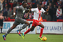 Lucas Akins of Stevenage escapes from Claude Davis of Rotherham<br />  - Stevenage v Rotherham United - Sky Bet League 1 - Lamex Stadium, Stevenage - 16th November, 2013<br />  © Kevin Coleman 2013